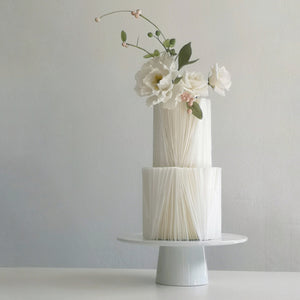 Professional online cake decorating class by Crummb teaches how to emboss beautiful 3D geometrical pattern on fondant