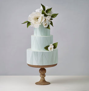 Beautiful grey-green wedding cake with embossed fondant texture that resemble ceramic tiles