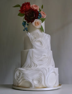 Stunning wedding cake with free-flowing wafer paper swirls and sugarflower decoration