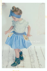 Autumn Pastures: Girls cotton skirt in blue with navy dots and tan horse print pockets. Twirl skirt with high, retro waist. Retro style made modern. Made in the USA.