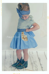 Girls cotton skirt with pockets. Blue and tan. Spring, summer and autumn wear.