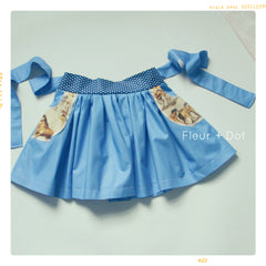Fleur + Dot girls cotton skirt in blue. Pockets and bow. Vintage inspired and modern. Made in the USA by Fleur and Dot.