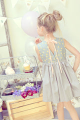 Tie back polka dot party dress. Girls vintage inspired dress by Fleur + Dot