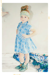 Blue linear modern print cotton girls dress in shirtdress style with collar and bow