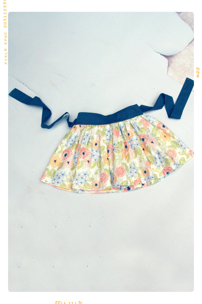 Girls floral cotton skirt by Fleur + Dot. Vintage inspired and handmade. Retro fit.
