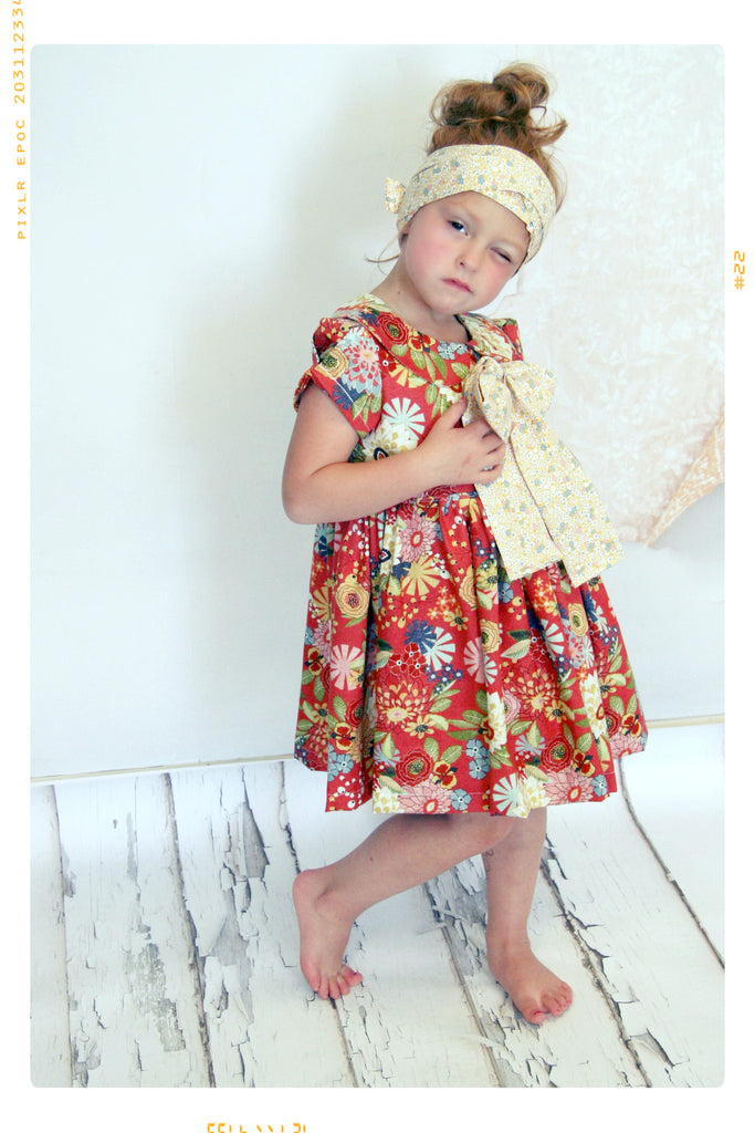 Floral cotton peter pan collar girls dress by Fleur + Dot. Red and yellow floral and vintage inspired with Peter Pan Collar and puff sleeves.