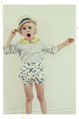 Kids vintage style collared shirt in blue and yellow floral cotton.