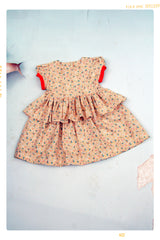 vintage inspired girls floral dress with modern citrus colors. Fleur and Dot.