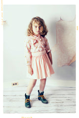 Pink polka dot girls twirl skirt in cotton with elastic waistband by Fleur + Dot. Slow fashion.