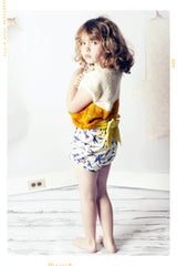 Vintage inspired huge bow shorts in retro airplane print cotton for girls. Made in the USA.