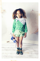 Green polka dotted bubble shorts for girls in line and dot striped cotton.