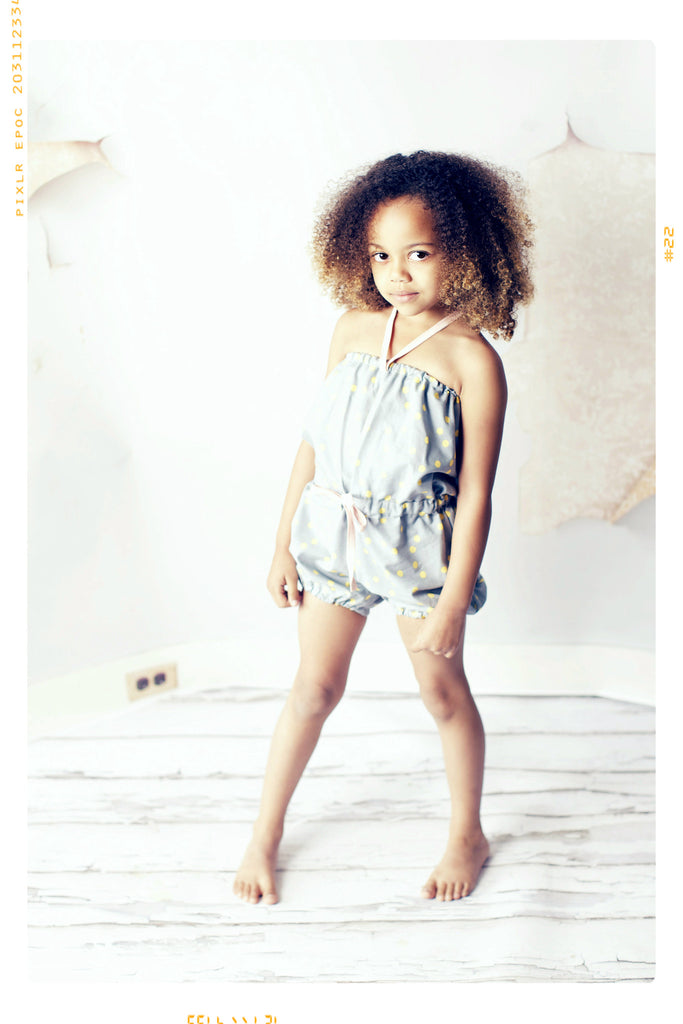 Girls cotton romper bathing suit in grey with gold dots and pink bows by Fleur + Dot. Slow fashion. Handmade. USA.