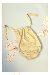 Girls vintage inspired bow romper with floral bow hand made by Fleur + Dot in the USA. Slow fashion.
