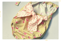 Fleur + Dot romper for girls in bow and floral print cotton with halter style top.