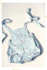 Girls blue floral vintage romper onsie in cotton with bow and bubble bloomer shorts.