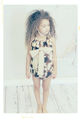 Oversized bow romper in cow print and floral cotton. Baby girl vintage modern bathing suit. Fleur + Dot