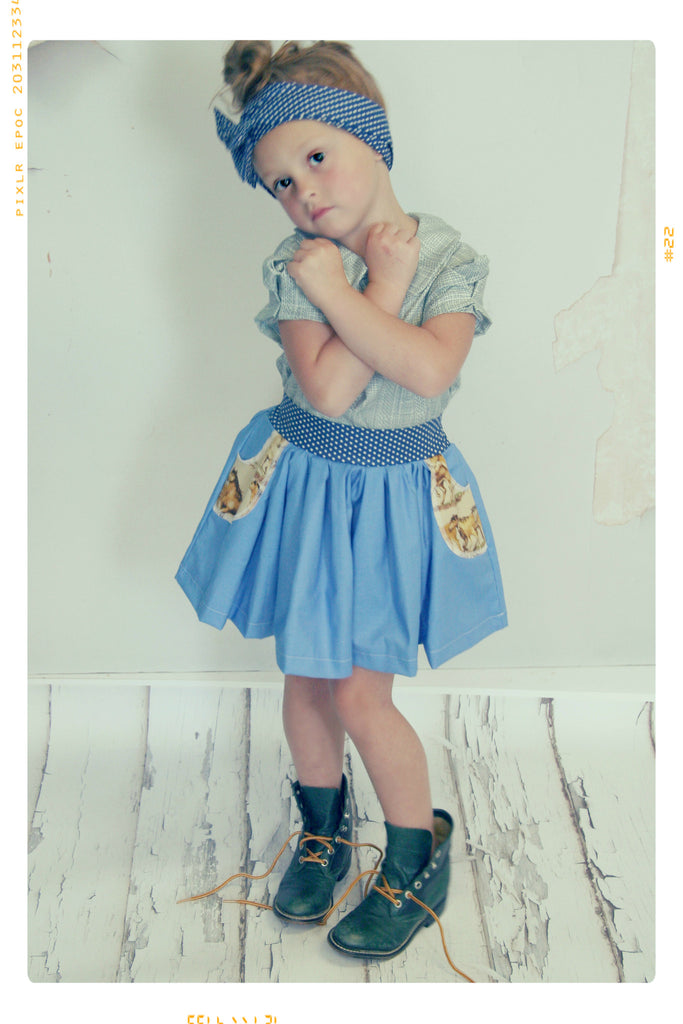 Retro style girls cotton skirt in blue and dot and horse print by Fleur + Dot. Slow fashion made in the USA.