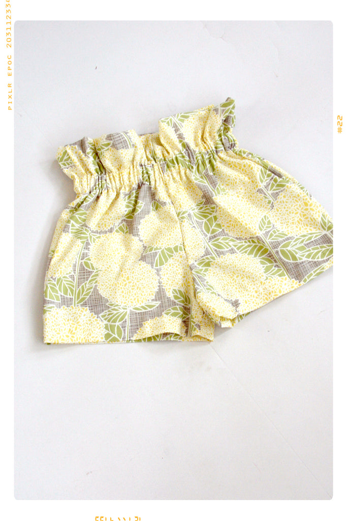 Girls cotton high waist floral cotton shorts in yellow flowers print. Vintage inspired by Fleur + Dot.