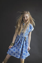Girls blue cotton dress in vintage shirtdress style with bow and collar