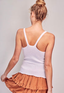 Back of knitted white tank in a racerback