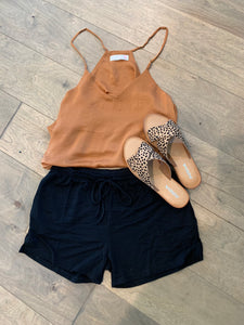 Rust color tank with asymmetrical hem and vneck