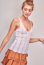 Load image into Gallery viewer, Model is wearing white knitted tank with v neack and scalloped hem and rust ruffled colored skirt.