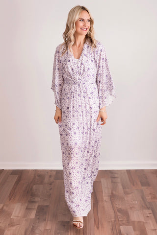 Purple maxi dresses flared at the bottom