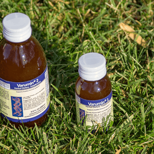 Varumin 1 and Varumin 2 product bottles in a grass