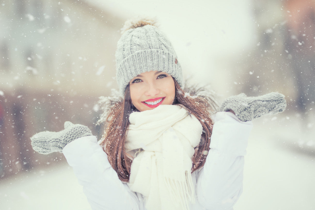 Woman in white clothes posing in winter