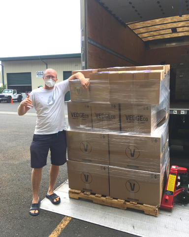 Trevor Hitch VEDGEco CEO loading VEDGEco boxes in Hawaii