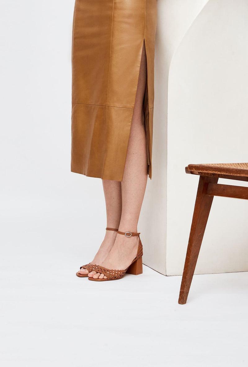 Pair of Tan Handwoven Leather Designer Sandals, model PROCIDA, by French Designer Shoes brand Souliers Martinez, worn by model