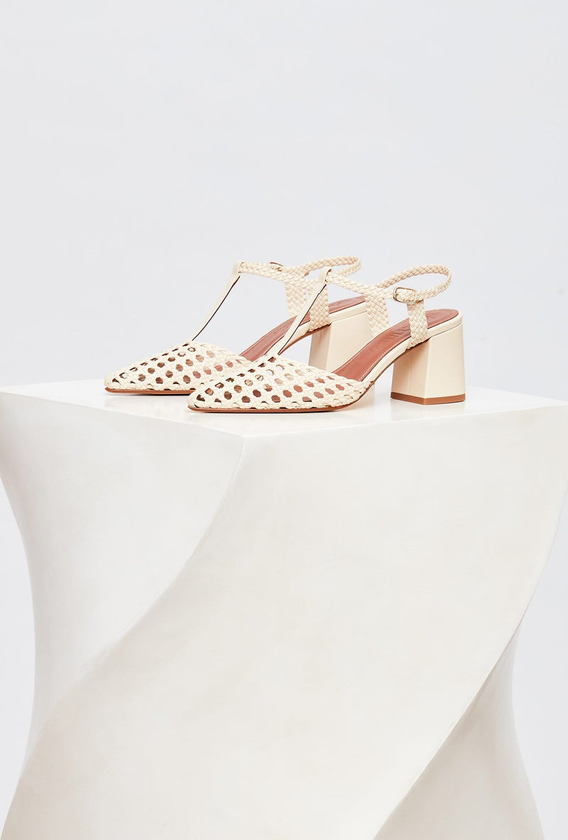 Pair of Off-White Leather Designer Heels, model SEVILLA, by French Designer Shoes brand Souliers Martinez, side view