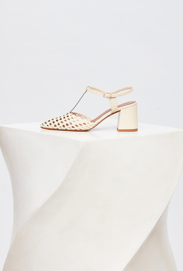 Off-White Leather Designer Heels, model SEVILLA, by French Designer Shoes brand Souliers Martinez, side view of the left shoe