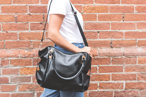 Woman with black leather bag