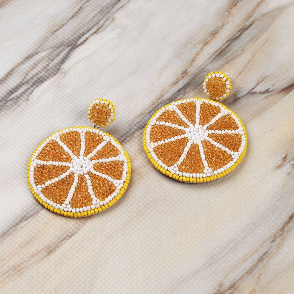 Deepa Gurnani Handmade Lemon Earrings on Marble Background