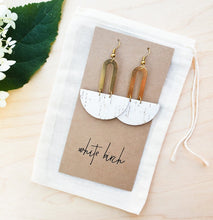 Load image into Gallery viewer, Half Moon White Cork Leather & Horseshoe Brass Circle Dangle Earrings