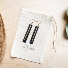 Load image into Gallery viewer, Black Leather Rectangular Bar Earrings with a Brass Bar Accent