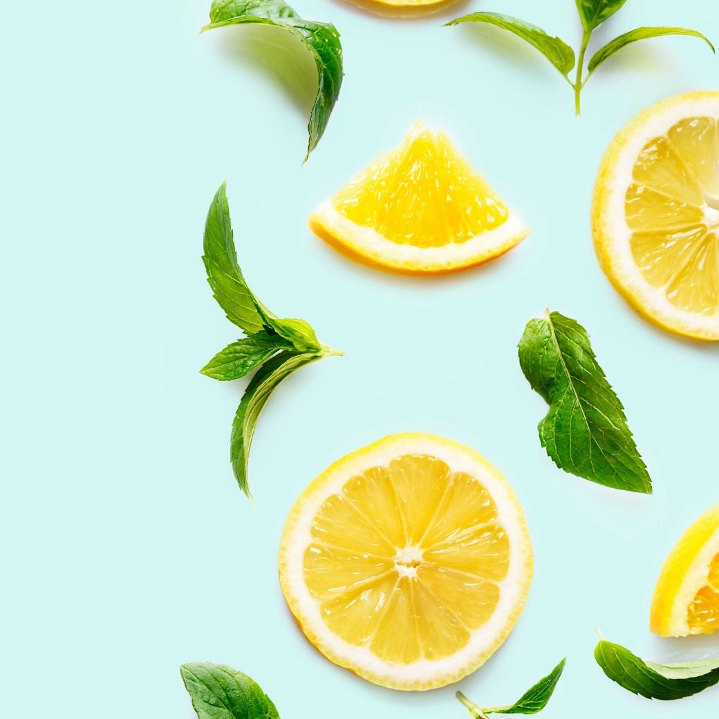 Photo: Mint Springs and Lemon Slices against a Blue flat lay background