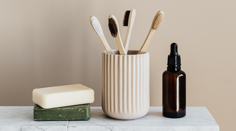Soap, toothbrushes, and an amber glass bottle