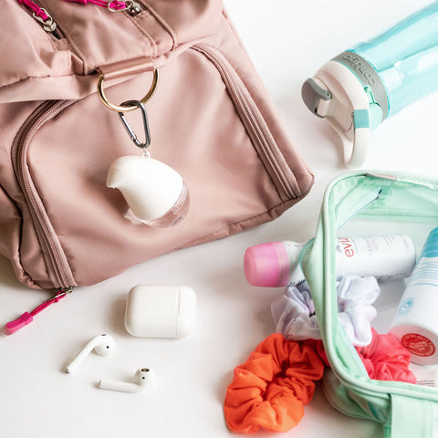 OLIKA Gym Bag Flat Lay featuring Clip-On Hand Sanitizer