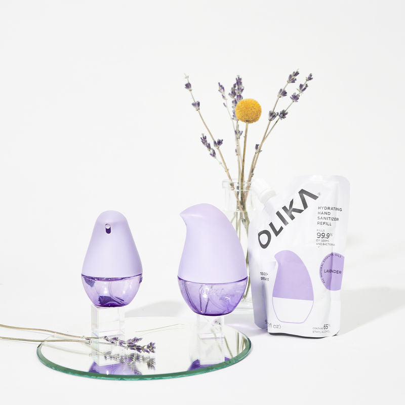 Items Pictured: OLIKA Spray, Clip-on, and Refill Hydrating Hand Sanitizers in Lavender