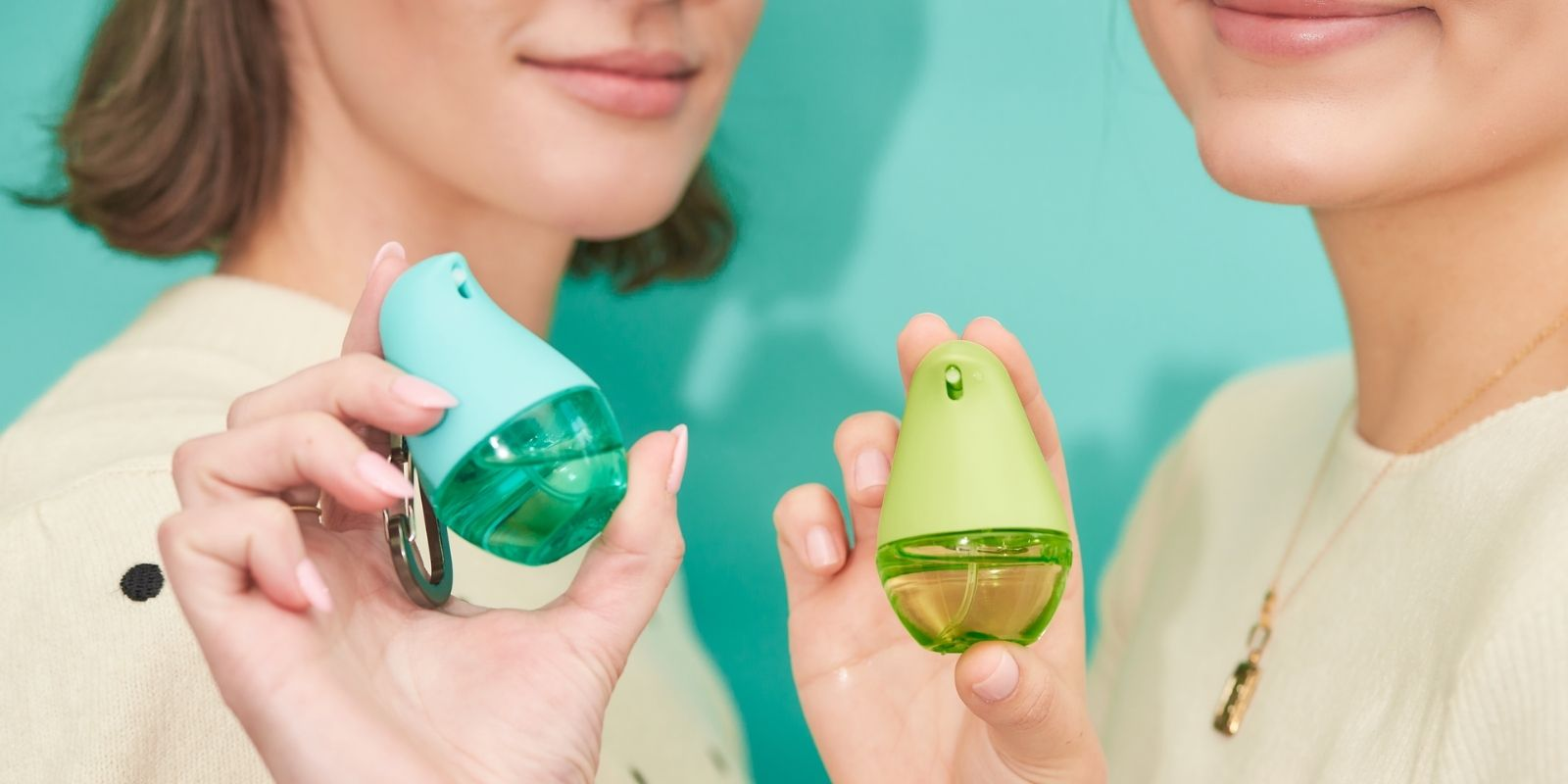 Items Pictured: Hands holding OLIKA Spray and Clip-on Hydrating Hand Sanitizers in Mint Citrus and Cucumber Basil