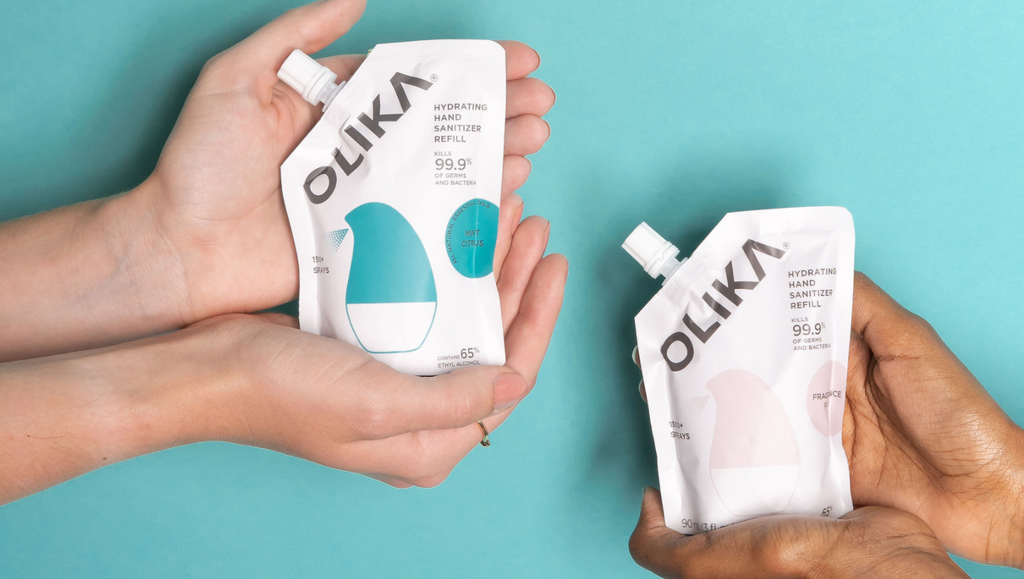 hands holding OLIKA refill pouches