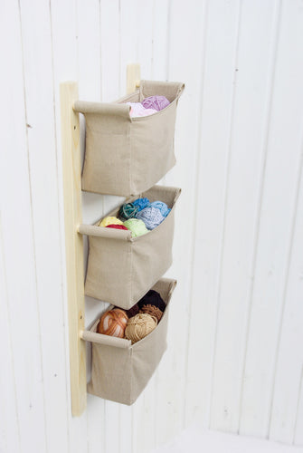 Nursery wall hanging organizer with beige fabric bins (more colour options)