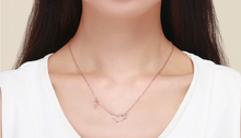 Load image into Gallery viewer, Capricorn zodiac constellation necklace on woman