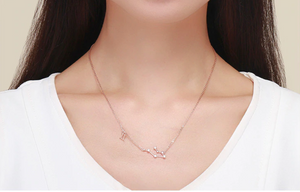 Gemini zodiac constellation necklace on woman