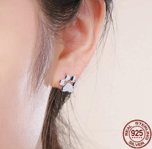 Load image into Gallery viewer, Stud paw earrings in silver on woman