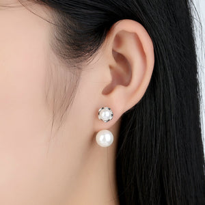 Front and back pearl earrings on woman