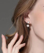 Load image into Gallery viewer, Front and back pearl earrings on woman