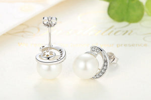 Silver pearl earrings with cubic zirconia